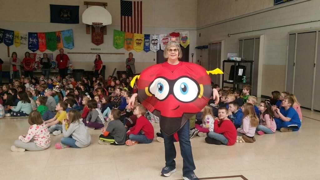 Mrs. Johnson and the children at the Kids Heart Challenge Assembly